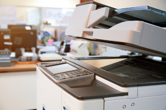 Close up of an office printer to demonstrate the importance of Managed Print Services