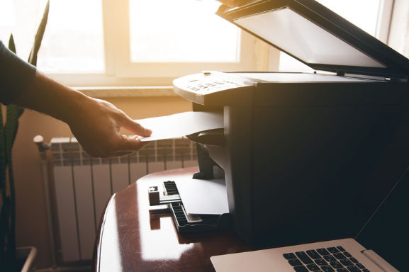 Getting the printed paper from a multifunction printers